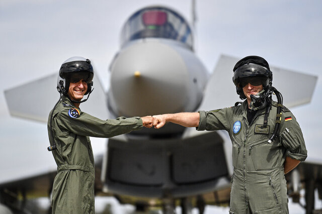 A pilot from Israel, left, and a pilot from Germany, right, pose in front of an Eurofighter at the airbase in Noervenich, Germany, Thursday, Aug. 20, 2020. Pilots from Israel and Germany will fly together the next two weeks during the first joint military Air Force exercises between the two nations in Germany. (AP Photo/Martin Meissner)