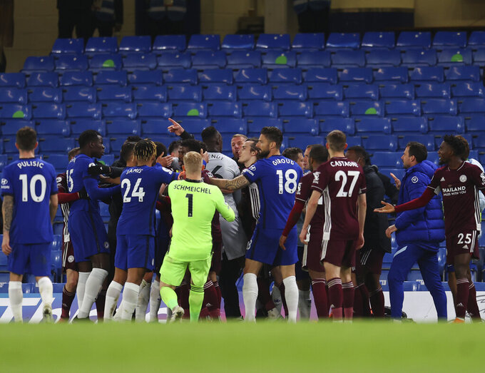 Leicester City and Chelsea players clash during the English Premier League soccer match between Chelsea and Leicester City at Stamford Bridge Stadium in London, Tuesday, May 18, 2021. (Catherine Ivill/Poolvia AP)
