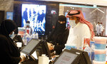 Saudi movie viewers wear face masks to help curb the spread of the coronavirus, as they buy refreshments at VOX Cinema hall in Jiddah, Saudi Arabia, Friday, June 26, 2020, after the announcement of easing of lockdown measures amid the coronavirus outbreak. (AP Photo/Amr Nabil)