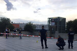 Police officers investigate where an assailant stabbed one person to death and injured nine others and has been arrested, Saturday Aug.31, 2019 just outside a subway station in Villeurbanne, outside Lyon, central France. The reason for the attack is unclear. (AP Photo/Nicolas Vaux-Montagny)