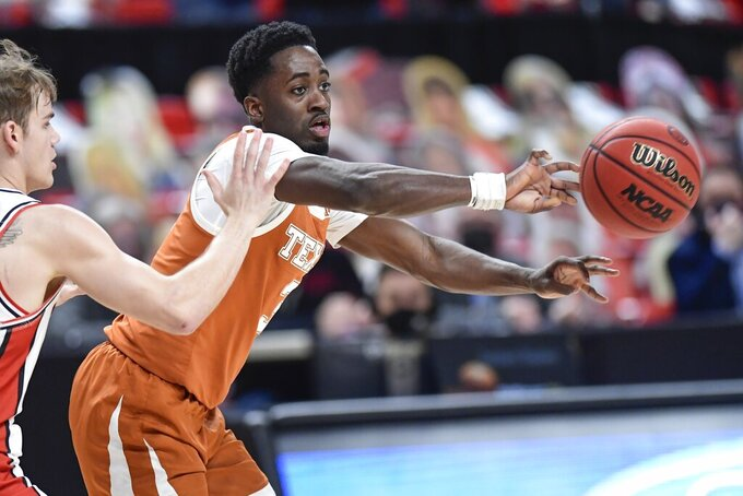 Texas' Courtney Ramey (3) passes the ball during the first half of an NCAA college basketball game against Texas Tech in Lubbock, Texas, Saturday, Feb. 27, 2021. (AP Photo/Justin Rex)