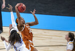Texas forward Charli Collier (35) pulls down a rebound against UCLA forward Michaela Onyenwere (21) during the first half of a college basketball game in the second round of the women's NCAA tournament at the Alamodome in San Antonio, Wednesday, March 24, 2021. (Ricardo B. Brazziell/Austin American-Statesman via AP)