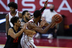 Southern California forward Evan Mobley, right, keeps a rebound away from Oregon State guard Julien Franklin (22) and forward Maurice Calloo during the first half of an NCAA college basketball game Thursday, Jan. 28, 2021, in Los Angeles. (AP Photo/Ashley Landis)