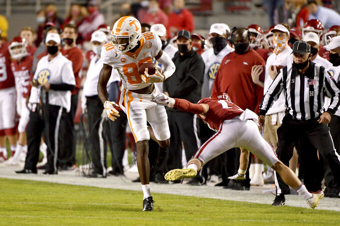 Tennessee receiver Ramel Keyton tries to get by Arkansas' Hudson Clark during the first half of an NCAA college football game Saturday, Nov. 7, 2020, in Fayetteville, Ark. (AP Photo/Michael Woods)