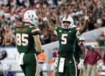 Miami quarterback N'Kosi Perry (5) encourages the crowd to cheer during the second half of an NCAA college football game against Florida State, Saturday, Oct. 6, 2018, in Miami Gardens, Fla. Miami won 28-27. (AP Photo/Lynne Sladky)
