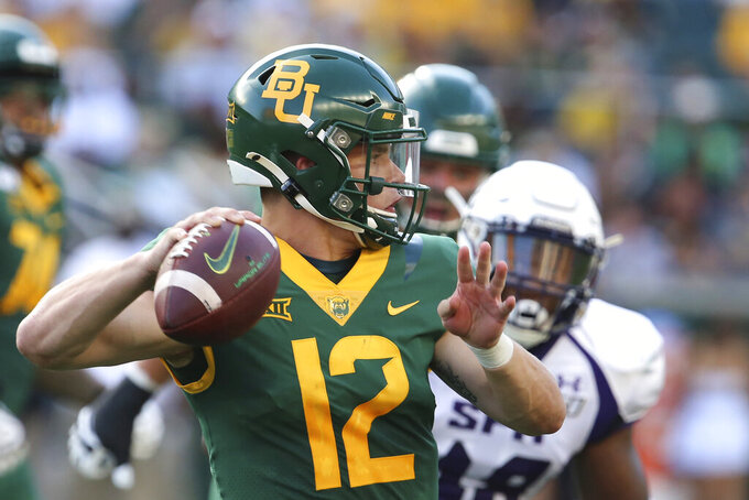 FILE - In this Aug. 31, 2019, file photo, Baylor quarterback Charlie Brewer throws downfield against Stephen F. Austin in the first half of an NCAA college football game, in Waco, Texas. Charlie Brewer is finally entrenched as Baylor's quarterback in his third season starting games. Frank Harris, also a touted dual-threat recruit as a Texas high school senior three years ago, is just getting started at UTSA. (Rod Aydelotte/Waco Tribune-Herald via AP, File)