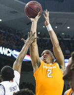 FILE - In this March 9, 2019, file photo, Auburn forward Horace Spencer (0) defends a shot by Tennessee forward Grant Williams (2) during the first half of an NCAA college basketball game, in Auburn, Ala. Grant Williams was selected to The Associated Press All-America first team, Tuesday, April 2, 2019. (AP Photo/Julie Bennett, File)