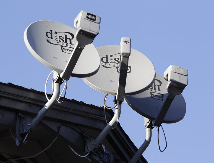 FILE - In this Feb. 23, 2011, file photo, Dish Network satellite dishes are shown at an apartment complex in Palo Alto, Calif. U.S. regulators are approving T-Mobile's $26.5 billion takeover of rival Sprint, despite fears of higher prices and job cuts. The approval on Friday, July 26, 2019, by the Justice Department and five state attorneys general comes after Sprint and T-Mobile agreed to conditions that would set up satellite-TV provider Dish as a fourth wireless company, so the number of major U.S. providers remains at four. (AP Photo/Paul Sakuma, File)