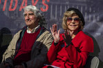 Actors Sam Waterston, left, and Jane Fonda attend a rally on Capitol Hill in Washington, Friday, Oct. 18, 2019. A half-century after throwing her attention-getting celebrity status into Vietnam War protests, Fonda is now doing the same in a U.S. climate movement where the average age is 18. (AP Photo/Manuel Balce Ceneta)