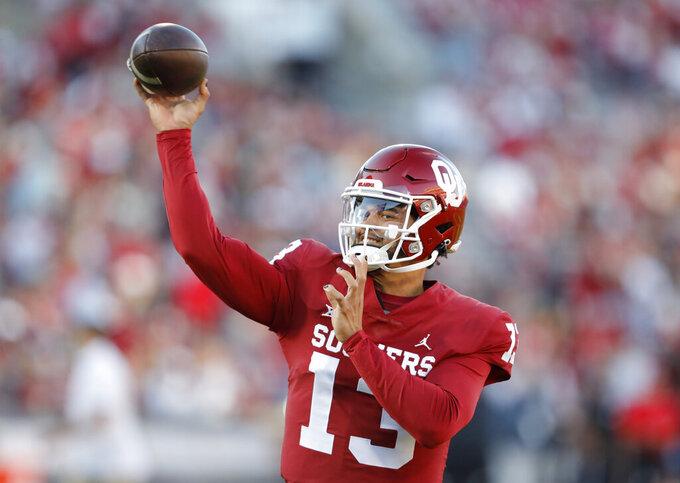 Oklahoma quarterback Caleb Williams (13) warms up before an NCAA college football game against TCU, Saturday, Oct. 16, 2021, in Norman, Okla. (AP Photo/Alonzo Adams)