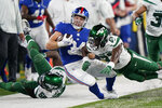 New York Giants running back Sandro Platzgummer (34) is knocked out of bounds on a run against New York Jets defensive back Corey Ballentine (27) in the second half of an NFL preseason football game, Saturday, Aug. 14, 2021, in East Rutherford, N.J. (AP Photo/Corey Sipkin)