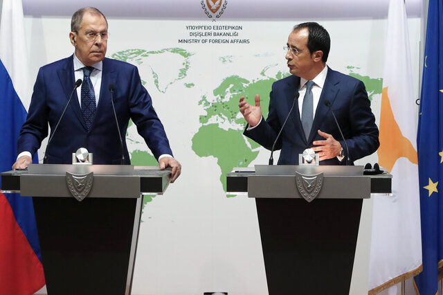 Russian Foreign Minister Sergey Lavrov, left, and his Cypriot counterpart Nikos Christodoulides talk to the media during a press conference at the foreign ministry house in Nicosia, Cyprus, Tuesday, Sept. 8, 2020. Lavrov is paying an official visit to Cyprus amid heightened tensions over Turkey's search for energy resources in east Mediterranean waters where Greece and Cyprus claim as having exclusive economic rights. (AP Photo/Petros Karadjias)