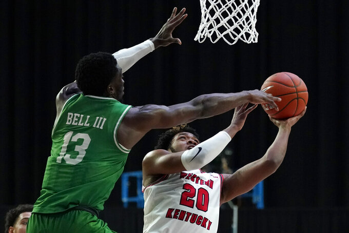 Western Kentucky guard Dayvion McKnight (20) shoots over North Texas forward Thomas Bell (13) during the second half of the championship game in the NCAA Conference USA men's basketball tournament Saturday, March 13, 2021, in Frisco, Texas. (AP Photo/Tony Gutierrez)