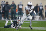 Penn State's KJ Hamler, right, runs past Michigan State's Jude Pedrozo on a punt return during the fourth quarter of an NCAA college football game, Saturday, Oct. 26, 2019, in East Lansing, Mich. (AP Photo/Al Goldis)