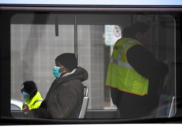 A commuter wears a mask while riding The Hop on Tuesday, March 31, 2020 in Milwaukee.  (Mark Hoffman/Milwaukee Journal-Sentinel via AP)