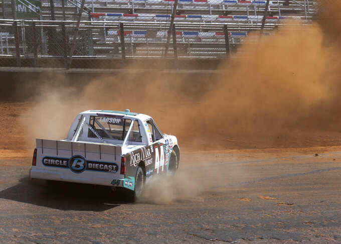 Kyle Larson spins out along the dirt track during NASCAR Truck Series practice, Friday, March 26, 2021, at Bristol Motor Speedway in Bristol, Tenn. (David Crigger/Bristol Herald Courier via AP)
