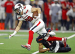 Texas Tech's Caden Leggett (89) tries to break away from John Davis Jr. (17) during an NCAA college football spring game, Saturday, April 13, 2019, in Frisco, Texas. (Brad Tollefson/Lubbock Avalanche-Journal via AP)