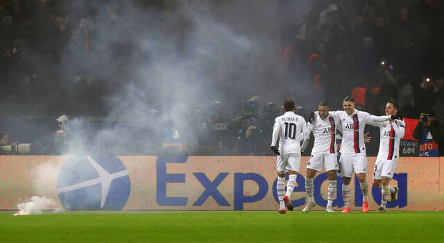 PSG's Kylian Mbappe, second from left, celebrates after scoring his side's fourth goal, with his teammates Neymar, left, Mauro Icardi and Pablo Sarabia, during the Champions League, group A soccer match between PSG and Galatasaray, at the Parc des Princes stadium in Paris, Wednesday, Dec. 11, 2019. (AP Photo/Michel Euler)