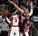 Mississippi State guard Quinndary Weatherspoon (11) attempts to block a shot by Mississippi guard Terence Davis (3) in the first half of an NCAA college basketball game, Saturday, Jan. 12, 2019 in Starkville, Miss. (AP Photo/Rogelio V. Solis)