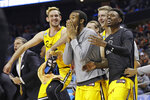 FILE - In this March 16, 2018, file photo, UMBC players celebrate a teammate's basket during the second half against Virginia at the NCAA men's college basketball tournament in Charlotte, N.C. UMBC defeated Virginia 74-54. (AP Photo/Gerry Broome, File)