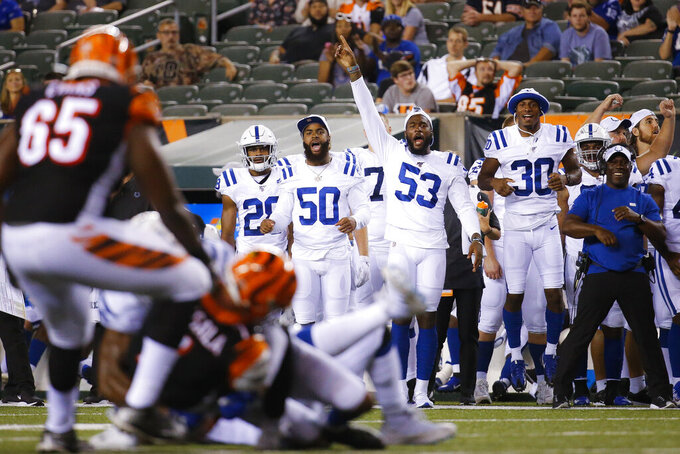 Indianapolis Colts middle linebacker Anthony Walker (50), outside linebacker Darius Leonard (53), and defensive back George Odum (30) react on the sideline during the second half of the team's NFL preseason football game against the Cincinnati Bengals on Thursday, Aug. 29, 2019, in Cincinnati. (AP Photo/Frank Victores)