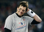 FILE - In this Jan. 21, 2018, file photo, New England Patriots quarterback Tom Brady smiles after winning the AFC championship NFL football game against the Jacksonville Jaguars, in Foxborough, Mass. Brady may not like strawberries, but he has skills when it comes to chugging beer. Appearing Monday, March 12, 2018, on CBS's