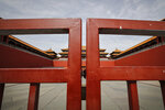 "FILE - In this Thursday, March 12, 2020 file photo, an entrance gate is closed at the usually crowded Forbidden City in Beijing, due to the COVID-19 coronavirus outbreak. Throughout January, the World Health Organization publicly praised China for what it called a speedy response to the new coronavirus. It repeatedly thanked the Chinese government for sharing the genetic map of the virus ""immediately,"" and said its work and its commitment to transparency were ""very impressive, and beyond words."" But behind the scenes, it was a much different story, one of significant delays by China and considerable frustration among WHO officials over not getting the information they needed to fight the spread of the deadly virus, The Associated Press has found. (AP Photo/Andy Wong)"