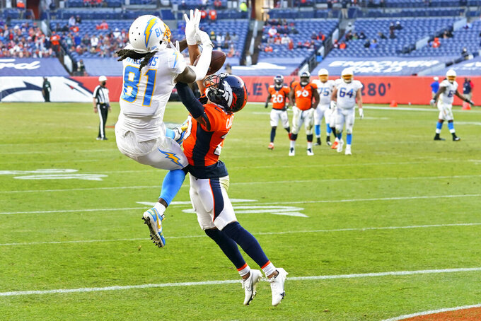 Denver Broncos strong safety Kareem Jackson (22) intercepts a pass in the end zone intended for Los Angeles Chargers wide receiver Mike Williams (81) during the second half of an NFL football game, Sunday, Nov. 1, 2020, in Denver. (AP Photo/David Zalubowski)