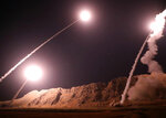 FILE - In this file photo released on Oct. 1, 2018, by the Iranian Revolutionary Guard, missiles are fired from city of Kermanshah in western Iran targeting the Islamic State group in Syria. Qassem Soleimani, Commander of Iran's Quds Force, was the frontman of Iran's Syria policy since 2011, propping up the embattled Assad as armed opposition against him intensified. (Sepahnews via AP, File)