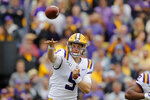 LSU quarterback Joe Burrow (9) passes in the first half of an NCAA college football game against Auburn in Baton Rouge, La., Saturday, Oct. 26, 2019. (AP Photo/Gerald Herbert)