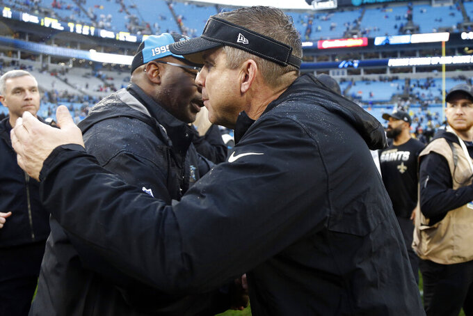 Carolina Panthers head coach Perry Fewell, left, and New Orleans Saints head coach Sean Payton speak folllowing an NFL football game in Charlotte, N.C., Sunday, Dec. 29, 2019. (AP Photo/Brian Blanco)