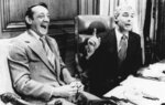 FILE - In this April 1977 file photo, San Francisco Supervisor Harvey Milk, left, and Mayor George Moscone sit together in the mayor's office during the signing of the city's gay rights bill. (AP Photo/File)