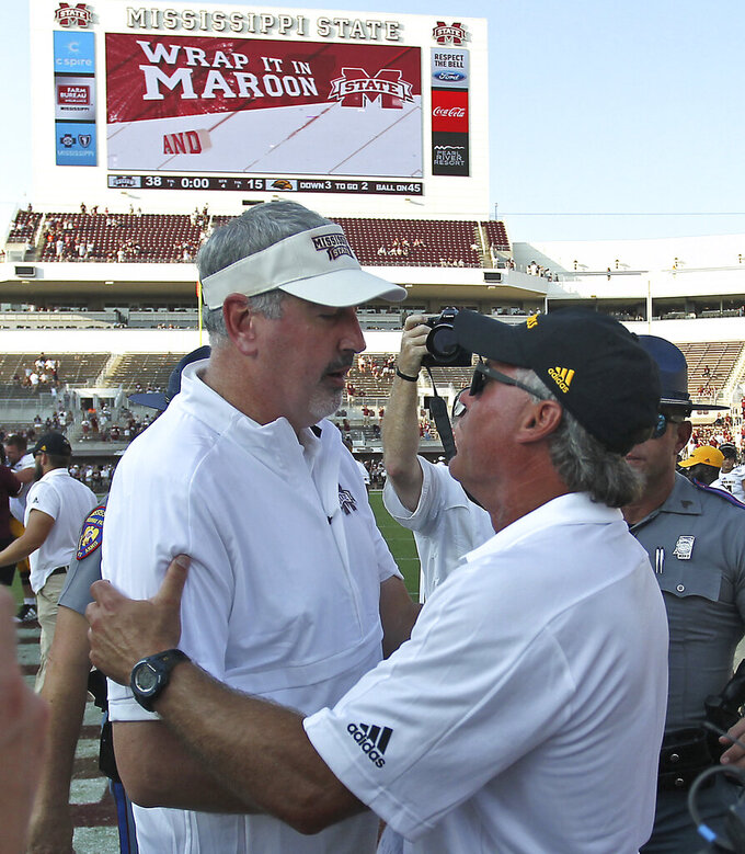 Southern Mississippi head coach Jay Hopson, right congratulates Mississippi State head coach Joe Moorhead, left on their 38-15 win in the NCAA college football game Saturday, Sept. 7, 2019, in Starkville, Miss. (AP Photo/Jim Lytle)