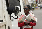 A vendor sells newspapers on a street in Harare, Zimbabwe, Saturday, Sept. 7, 2019. Former Zimbabwean leader Robert Mugabe, an ex-guerrilla chief who took power when the African country shook off white minority rule and presided for decades while economic turmoil and human rights violations eroded its early promise, has died in Singapore. He was 95. (AP Photo/Themba Hadebe)
