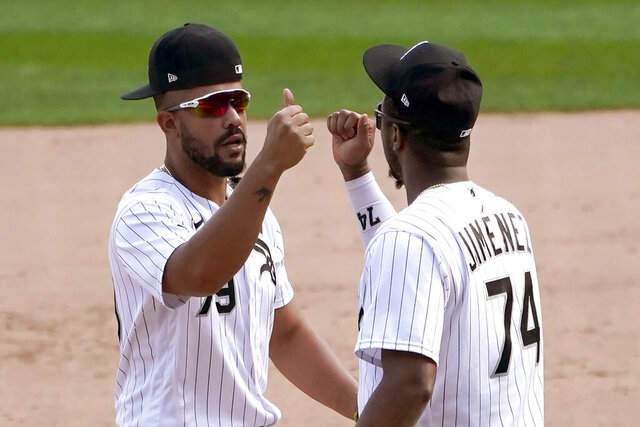 Chicago White Sox's Jose Abreu (79) and Eloy Jimenez celebrate the team's 4-3 win over the Minnesota Twins in a baseball game Thursday, Sept. 17, 2020, in Chicago. The White Sox clinched a playoff spot for the first time since 2008. (AP Photo/Charles Rex Arbogast)