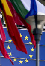 Flags of the European Union flap in the wind outside the European Parliament in Brussels, Friday, May 24, 2019. Some 400 million Europeans from 28 countries will head to the polls May 23-26 to choose lawmakers to represent them at the European Parliament for the next five years. (AP Photo/Virginia Mayo)