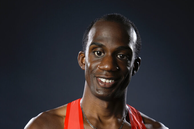 FILE - Blind Paralympic athlete Lex Gillette poses for photos at the 2016 Team USA Media Summit in Beverly Hill, Calif., in this Tuesday, March 8, 2016, file photo. Long jumper Lex Gillette is chasing after Paralympic gold after four straight silver medals. (AP Photo/Jae C. Hong, File)