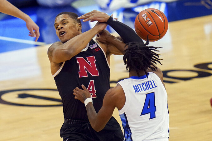 Creighton's Shereef Mitchell, right, fouls Nebraska's Shamiel Stevenson during the first half of an NCAA college basketball game in Omaha, Neb., Friday, Dec. 11, 2020. (AP Photo/Nati Harnik)