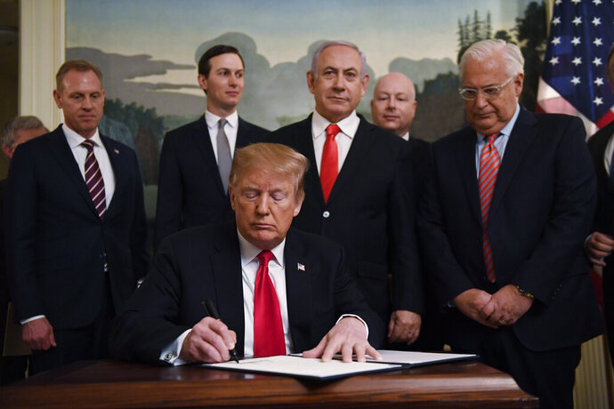 President Donald Trump signs a proclamation recognizing Israel's sovereignty over the Golan Heights, as Israeli Prime Minister Benjamin Netanyahu looks on, in the Diplomatic Reception Room of the White House in Washington, Monday, March 25, 2019. (AP Photo/Susan Walsh)