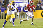 Alabama wide receiver DeVonta Smith (6) runs for a big gain against LSU defensive end Neil Farrell Jr. (92) during the first half of an NCAA college football game in Baton Rouge, La., Saturday, Dec. 5, 2020. (AP Photo/Matthew Hinton)
