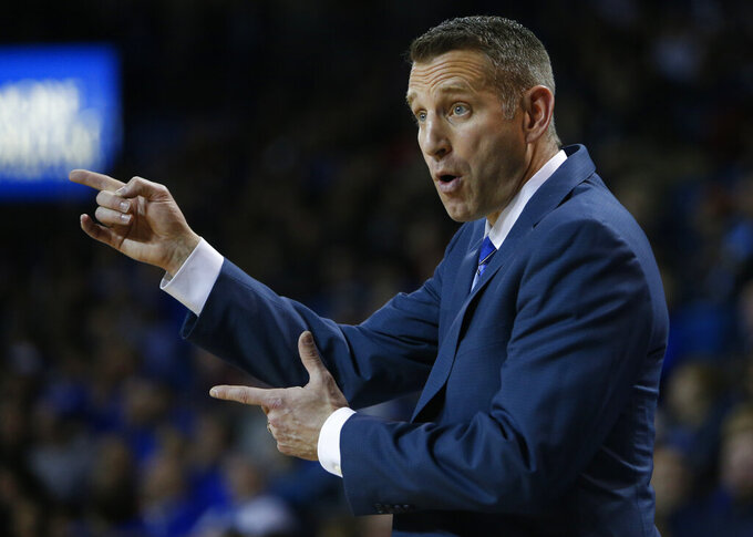 Buffalo head coach Nate Oates reacts during the second half of an NCAA college basketball game against Eastern Michigan, Friday, Jan. 18, 2019, in Buffalo N.Y. (AP Photo/Jeffrey T. Barnes)