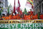 Oil workers march against layoffs at the state oil company Petrobras, in Rio de Janeiro, Brazil, Tuesday, Feb. 18, 2020. Brazilian oil workers and oil giant Petrobras were locked in a power struggle Tuesday over the company's privatization plans, with the union saying thousands of employees are on an indefinite strike. (AP Photo/Silvia Izquierdo)