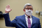 Census Bureau Director Steven Dillingham wears a mask with the words