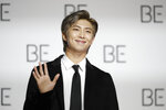 RM, a member of South Korean K-pop band BTS, poses for photographers during a press conference to introduce their new album