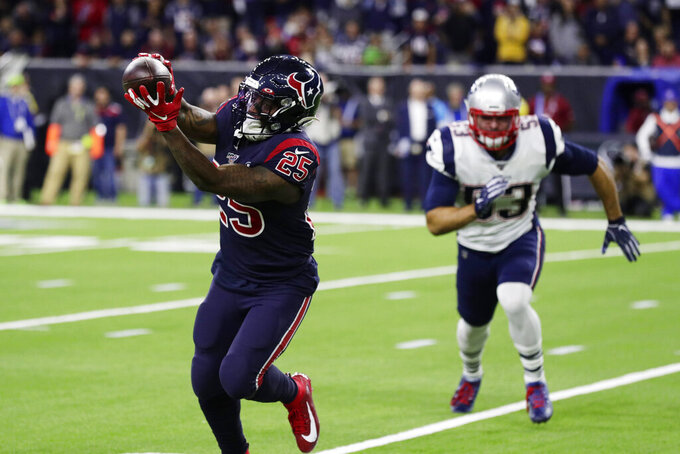 Houston Texans running back Duke Johnson (25) makes a catch for a touchdown in front of New England Patriots middle linebacker Kyle Van Noy (53) during the first half of an NFL football game Sunday, Dec. 1, 2019, in Houston. (AP Photo/Mike Marshall)