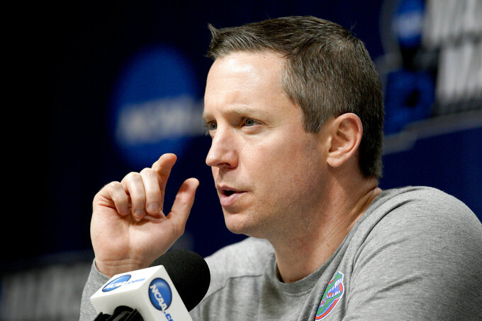 Florida coach Mike White speaks during a news conference the NCAA men's college basketball tournament in Des Moines, Iowa, Friday, March 22, 2019. Florida faces Michigan in the second round on Saturday. (AP Photo/Nati Harnik)