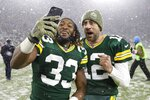 Green Bay Packers' Aaron Jones and Aaron Rodgers take a selfie after an NFL football game against the Carolina Panthers Sunday, Nov. 10, 2019, in Green Bay, Wis. The Packers won 24-16. (AP Photo/Mike Roemer)