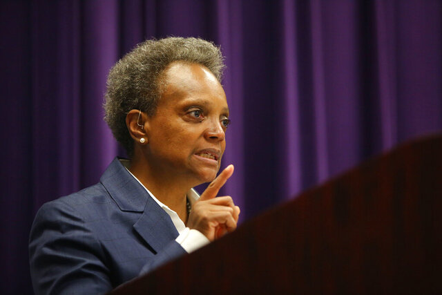 FILE - In this Aug. 10, 2020, file photo, Mayor Lori Lightfoot speaks at a news conference in Chicago. Illinois Senate Republicans urged Gov. J.B. Pritzker on Wednesday, Oct. 28, 2020, to release the specific data the Democrat is using to impose restrictions on indoor dining and bar service in an effort to slow the spread of the coronavirus. Senate Minority Leader Bill Brady called for a public hearing at which Pritzker would lay out the numbers he says show that the autumn surge in COVID-19 is fueled by close contact among restaurant and bar patrons. It came a day after he imposed the restrictions on Chicago. (Anthony Vazquez/Chicago Sun-Times via AP, File)