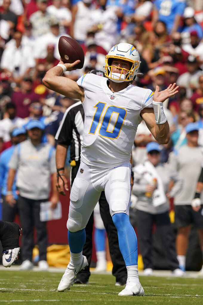 Los Angeles Chargers quarterback Justin Herbert (10) throwing the ball during the first half of an NFL football game against the Washington Football Team, Sunday, Sept. 12, 2021, in Landover, Md. (AP Photo/Andrew Harnik)