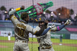 San Diego Padres' Fernando Tatis Jr., right, is congratulated by Jurickson Profar after hitting a solo home run against the San Francisco Giants during the fourth inning of a baseball game in San Francisco, Saturday, Sept. 26, 2020. (AP Photo/Eric Risberg)